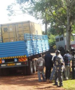 The huge lorry rumbles down the road to the Kisubi College. At a bend in the road it gets STUCK!